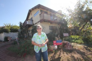 Margie Johnson and with her garden